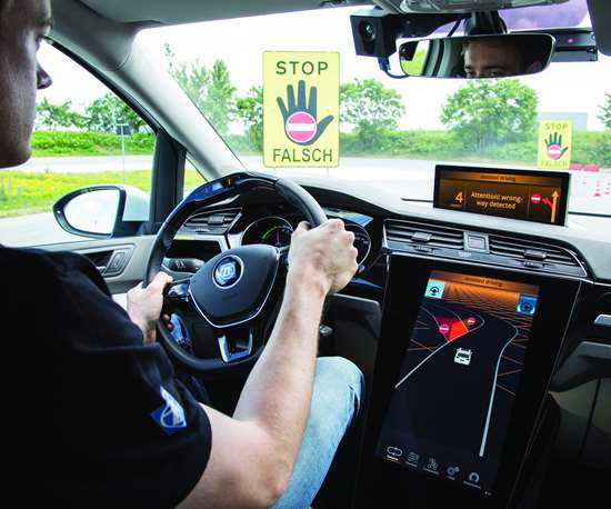 """While it may seem that a driver would see that large yellow sign—which is indicating that the driver is headed in the wrong direction, onto a freeway exit ramp—apparently that's not always the case, so ZF engineers have developed the """"Wrong-way Inhibit"""" system that not only provides audible and visual warnings, but will actually steer the car off to the side of the road and to a stop should the driver not take control."""