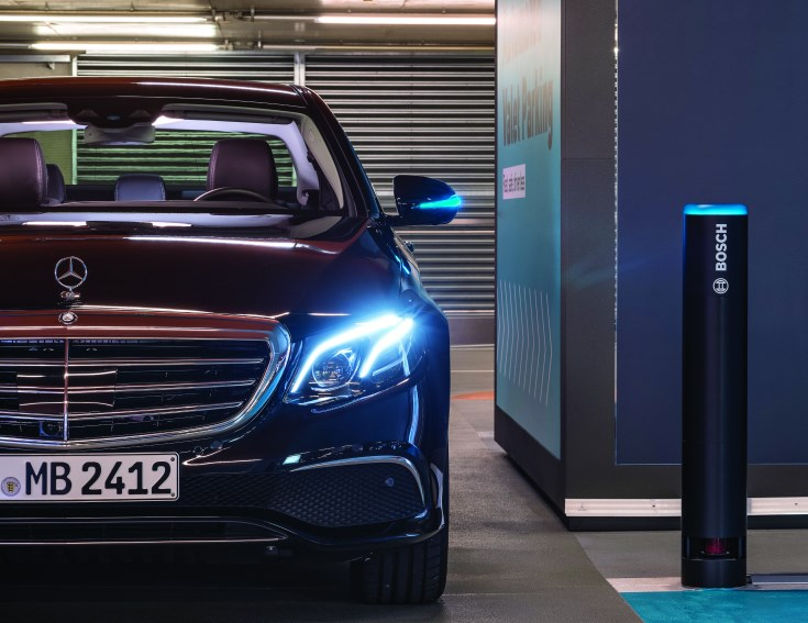 """Although it seems as though this S Class isn't going anywhere (as this is a static image), it is actually maneuvering through the multi-story parking deck at the Mercedes-Benz Museum in Stuttgart—on its own. The """"Bosch"""" labeled pole is a sensor that provides information on both whether the car is going to encounter anyone or anything, as well as parking availability. This capability is something that may make autonomy all the more appealing to even those who like driving—who likes parking?"""