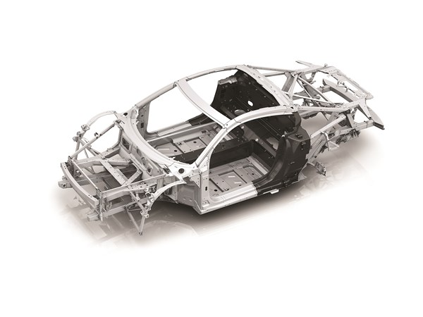 Audi's R8 combines an aluminum spaceframe with a center tunnel, back wall and B-pillars made of carbon fiber. This lightweight structure weighs 200 kg., making it just over twice as heavy as McLaren's Monocage II.