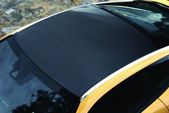 The optional carbon-fiber roof is produced with a high-speed resin transfer molding process at the Lexus Motomachi plant.