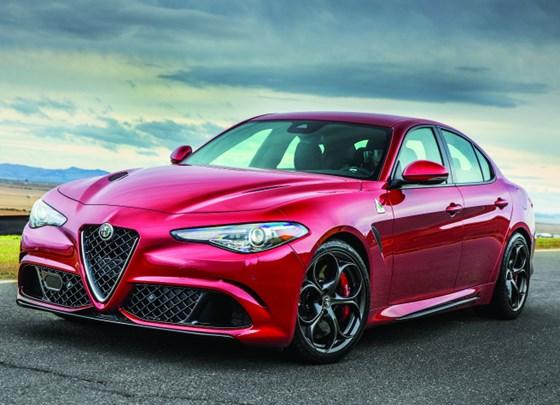 The Alfa Romeo Giulia Quadrifogilo. There is a 505-hp all aluminum twin-turbo under the hood. A carbon fiber hood.