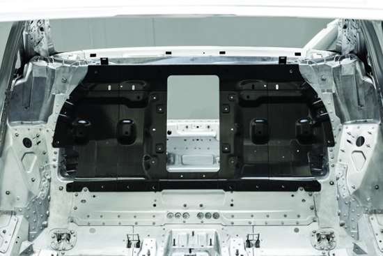 This carbon-fiber reinforced polymer is located behind the rear seat. It helps provide additional structural rigidity to the A8.