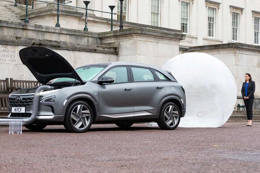 """Hyundai worked with researchers at the University College London on mapping London's """"dirtiest driving routes"""" with an eye toward helping mitigate some of that ambient exhaust. Shown here is a demonstration of particulate-ladened air going into a Nexo and clean coming out. Driving a Nexo for one hour can clean 29.6 kg (59.2 lb) of air—the amount 42 adults breathe in an hour."""