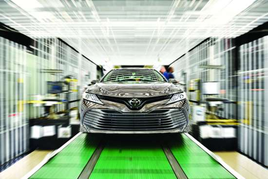 One of the cars styled at Calty that shows how Toyota is transforming its approach to design is the 2018 Camry, shown here coming off the line at the company's plant in Georgetown, Kentucky.