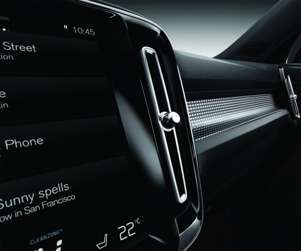 A portion of the standard 9-inch Sensus infotainment touch screen and the metallic deco trim above the glovebox. Addressing a younger demographic with both technology and a non-traditional treatment of interior trim.