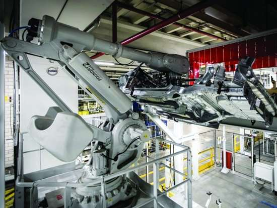 The Volvo Cars plant in Ghent, Belgium, is where the XC40 is produced. To launch the vehicle in the plant—where the V40, V40 Cross Country, S60 and V60 are also built—there was an 8,000-ft2 expansion of the body shop and the installation of 363 new robots, including this one, which lifts lower car bodies to a conveyor system that is near the ceiling of the factory.