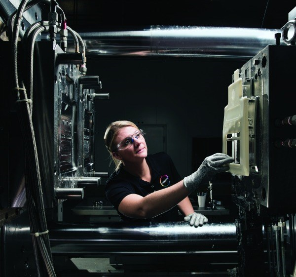 Direct coating technology combines conventional thermoplastic injection  molding with reaction injection molding (RIM) in a single tool for producing parts with a piano-black surface finish.