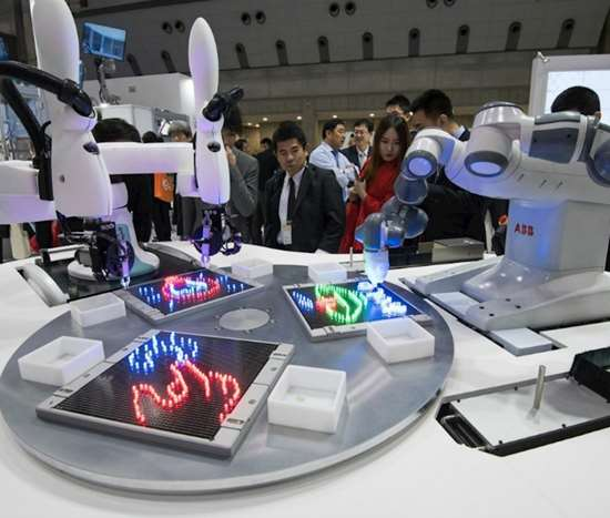 Joint demonstration of ABB's YuMI and Kawasaki's duAro collaborative robots using a common operating interface at the 2017 IREX fair in Tokyo, Japan.