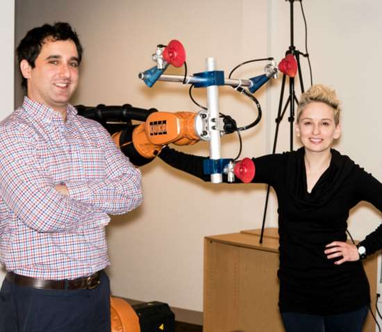 VEO Robotics senior director of hardware Scott Denenberg and VP of engineering Clara Vu flank a prototype version of the VEO system.