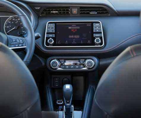 "The dashboard design is said to be based on the ""Gliding Wing"" theme. What is notable is that that 7-inch color touchscreen on the IP isn't an option for the high-end versions but is standard on every Kicks."