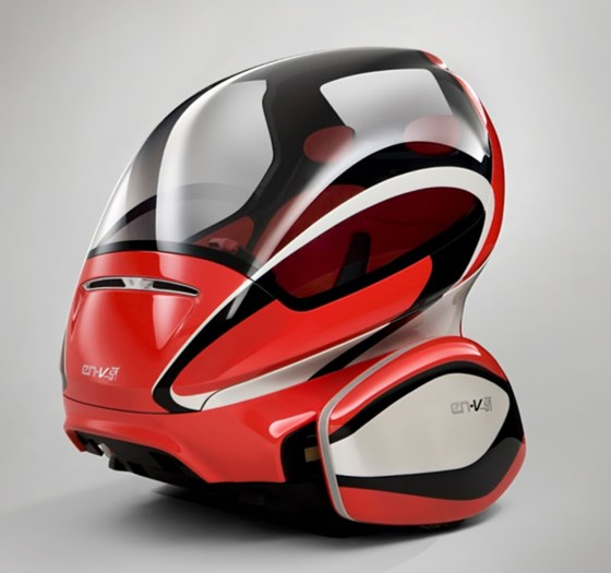 Out of Project P.U.M.A., a collaboration with Segway that GM had in 2009 for personal transportation devices that Burns supported, came EN-V—Electric Networked-Vehicle—that was demonstrated at the 2010 Shanghai World Expo. This is Jiao, one of three EN-V designs. Note that this is an electric V2X vehicle, the type of transportation that Burns promoted when there was more interest in things like Chevy Suburbans.