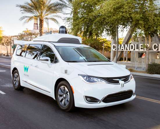 """A Waymo Pacific Hybrid minivan on the public roads in Chandler, Arizona, one of the vehicles in the early rider program that has been transporting people since April 2017. Burns: """"Autonomous driving technology does work."""" Right now."""