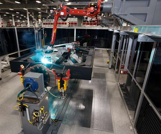 This fixture for the NSX spaceframe rotates 360°, allowing the robotic MIG welding to be performed throughout the structure.