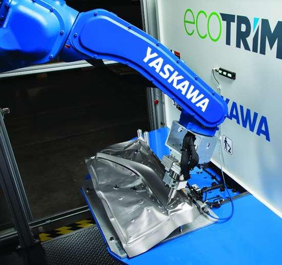 Using ultrasonics to cut fabric, like automotive trim.