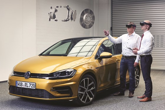 Volkswagen is using virtual reality to develop vehicles and even components, like the brake system shown here, being discussed by Frank Ostermann (left), Head of the Virtual Engineering Lab of Volkswagen Group IT and his colleague Konstantin Wall (right).