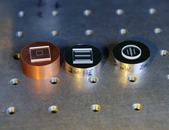 Samples of dissimilar materials welded by ultrafast laser: From left to right, silica welded to copper; silica welded to Invar; and sapphire welded to Invar.