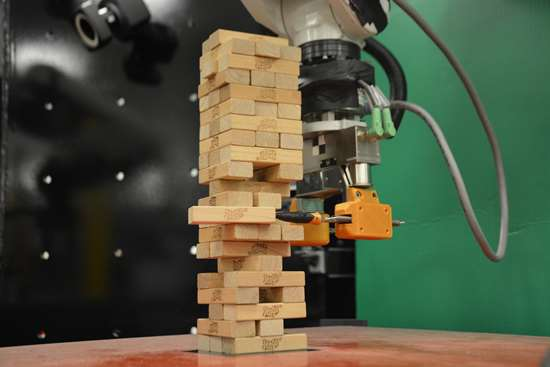 MIT's Jenga-playing robot learns not from a preloaded database of possible moves but by trying out moves itself.