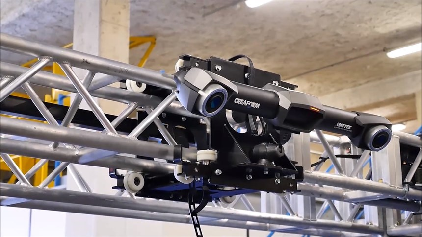 The C-Track optical tracker is positioned on a moveable gantry-like structure.