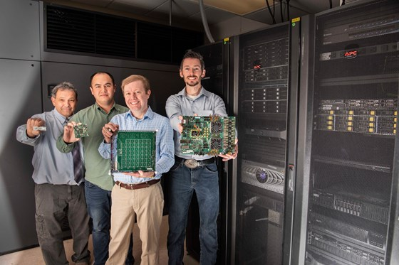 Sandia National Laboratories researchers, from left, Steve Verzi, William Severa, Brad Aimone and Craig Vineyard hold different versions of emerging neuromorphic hardware platforms. Sandia's new software, Whetstone, is designed to make artificial intelligence algorithms more efficient, enabling them on smaller, less power-hungry hardware. (Photo by Randy Montoya)