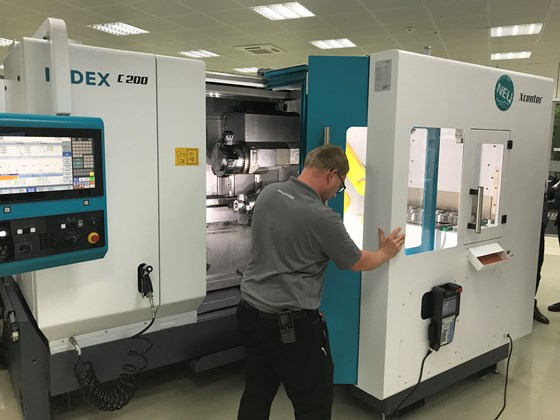 An Index employee demonstrates undocking the iXcenter cell from the work area of the C200.