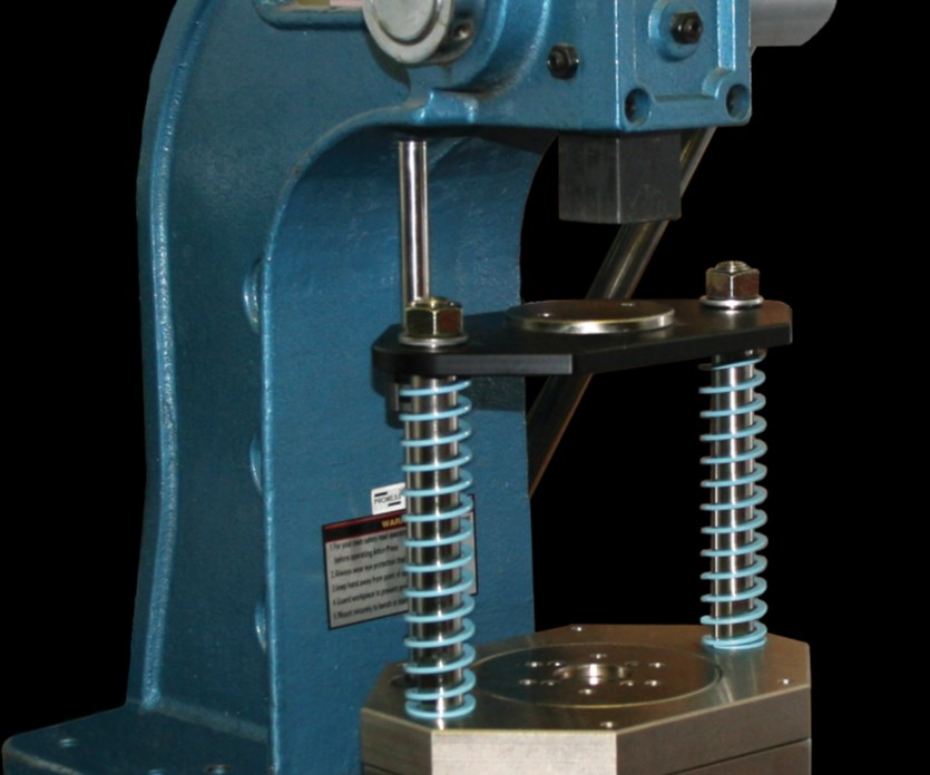 The Smart Press Frame, shown in place on a manual arbor press, monitors force and position.
