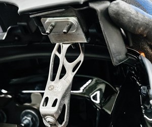 BMW i8 soft-top attachment component is 3D printed with aluminum. Note the organic shape of the component, with more mass being located in areas where loads need to be accommodated. The component weighs less than an injection molded plastic part that would otherwise be used. (Image: BMW)