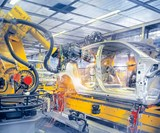 Robot guidance systems for automotive production