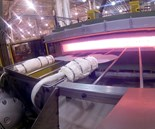 Hot blanks are pulled from a furnace for transfer to a press for forming and quenching, improving formability of ultra-high-strength steels. Photo courtesy Urgent Design and Manufacturing.