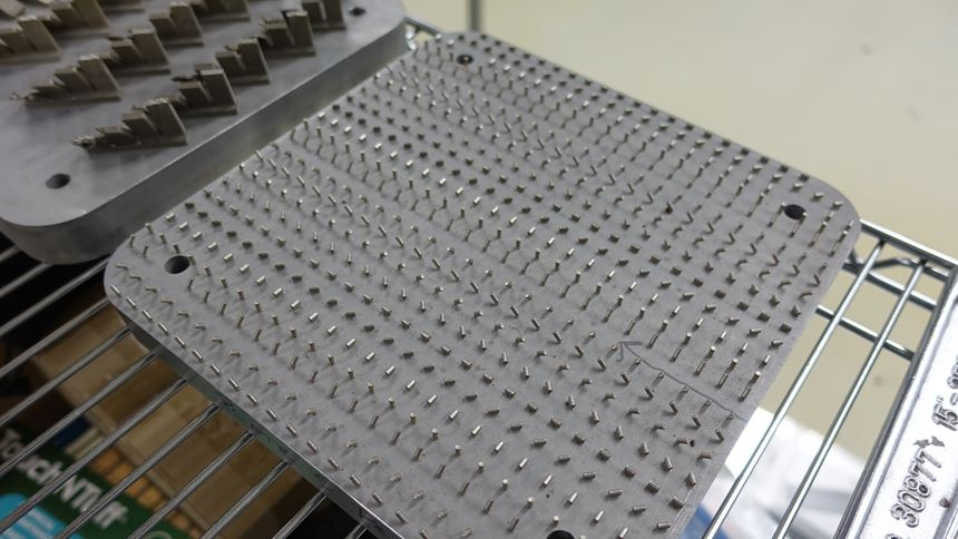 additive manufacturing test build with hundreds of small cylinders