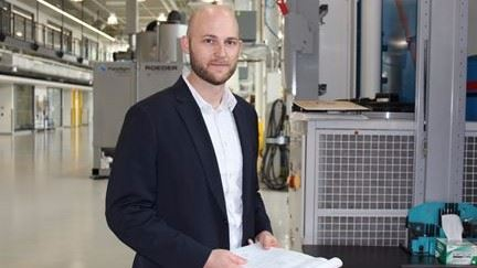 Brandon Lane, Ph.D., mechanical engineer in the Production System Group of NIST's Intelligent Systems Division