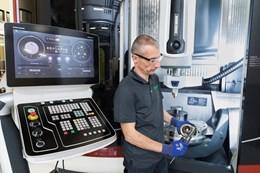 Schaeffler employee with DMG MORI Lasertec 65 3D hybrid