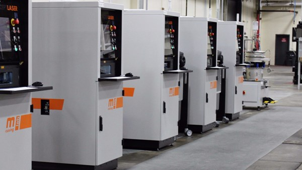a row of powder-bed machines for additive manufacturing