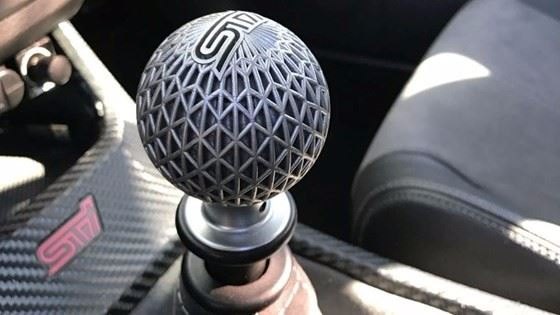 A metal 3D-printed shift knob, designed by PADT and manufactured with a Concept Laser Mlab to cool faster in a hot car than a conventional shift knob.