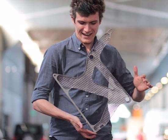 Andreas Bastian, research scientist, Autodesk, with magnesium cast airplane seat frame