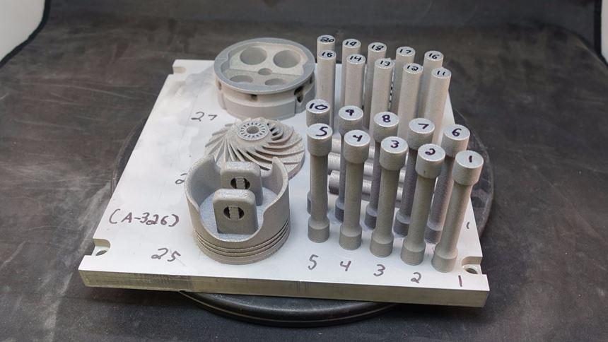 Build plate with 3D-printed metal matrix composite parts