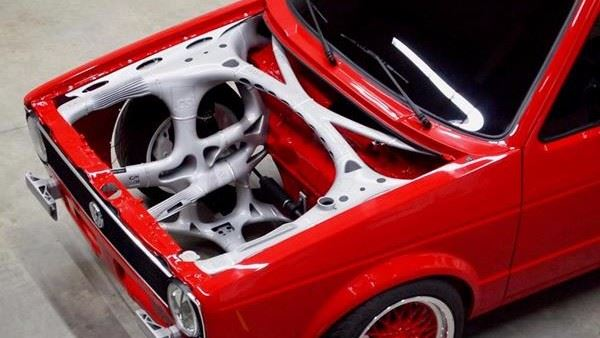 A VW Caddy with a 3D-printed front-end structure