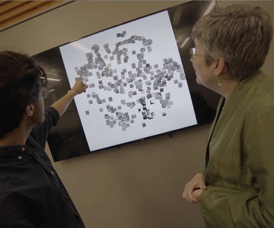 Elizabeth Holm, professor of materials science and engineering, Carnegie Mellon University, with student and computer vision system showing metal powder micrograph