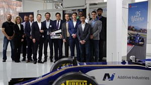 Representatives from Additive Industries hand over a MetalFab1 AM system to Sauber Motorsport AG.