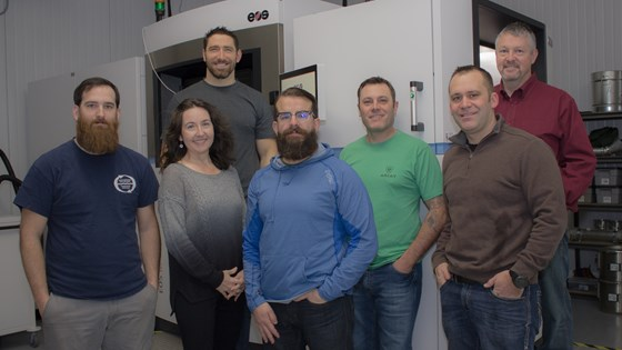 Integrated 3D Manufacturing (i3D) team in front of their new EOS M 400-4 DMLS system