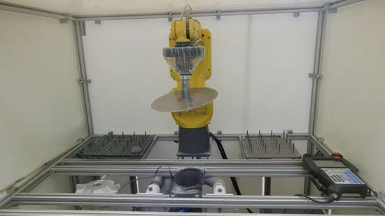 Automated finish blasting setup at Slice with custom fixtures and FANUC robot