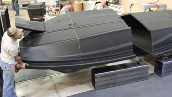 The assembly of the boat hull pattern sections.