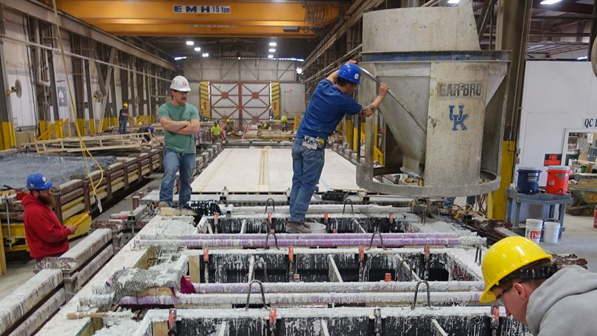 pouring concrete into 3D-printed form