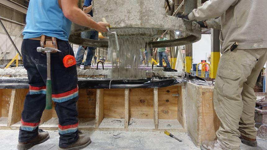 Concrete pouring into a form
