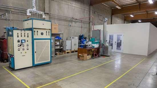 3DEO Gardena, California, facility interior showing sintering furnace and 3d printer pod