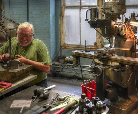 A&M Tool and Design employee with a bridgeport mill
