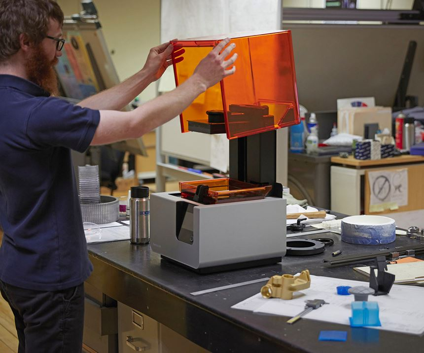 A&M Tool and Design employee with Formlabs Form 2 3D printer