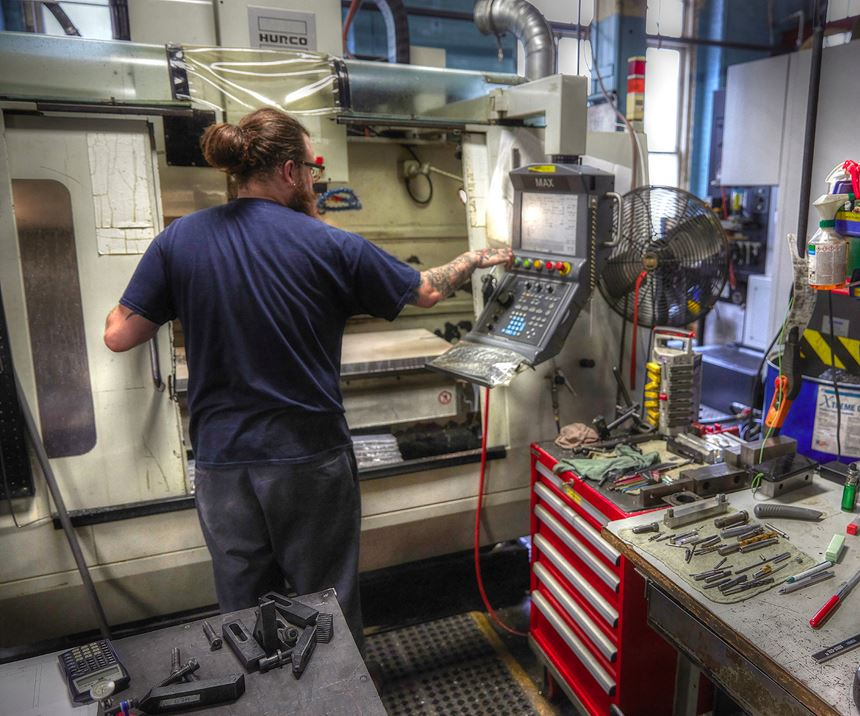 A&M Tool and Design employee programming a CNC