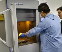 engineer removing benchmark parts from UnionTech Pilot 250 3d printer
