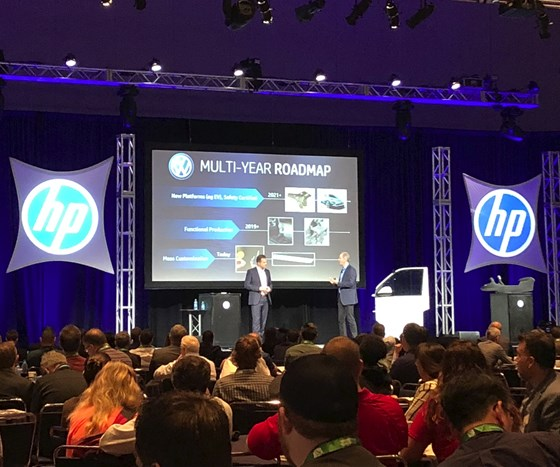 Dr. Martin Goede, head of technology planning and development at Volkswagen, on stage with Stephen Nigro, president of 3D printing at HP, during the keynote at the Additive Manufacturing Conference