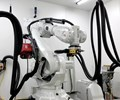 multi-axis ABB robot performing metal deposition 3D printing